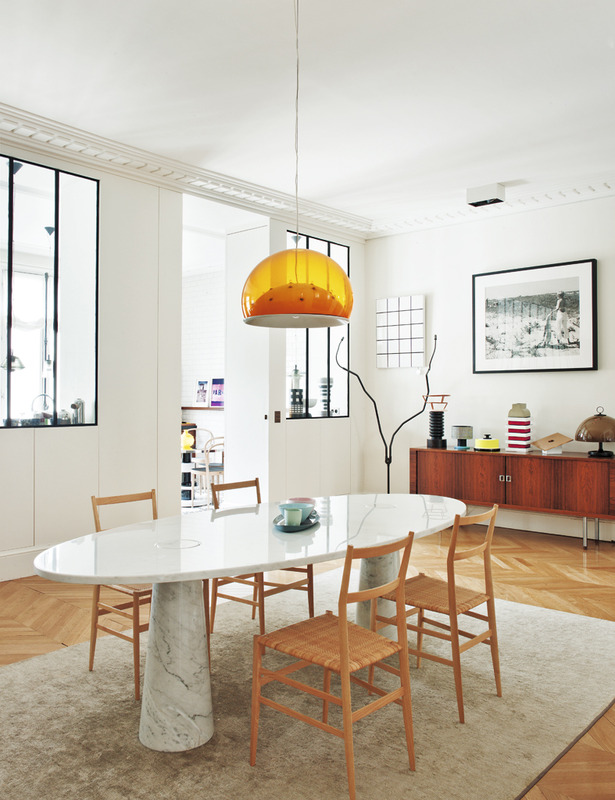 Marble dining table with wood chairs in Sandra Benhamou's Midcentury Paris Apartment