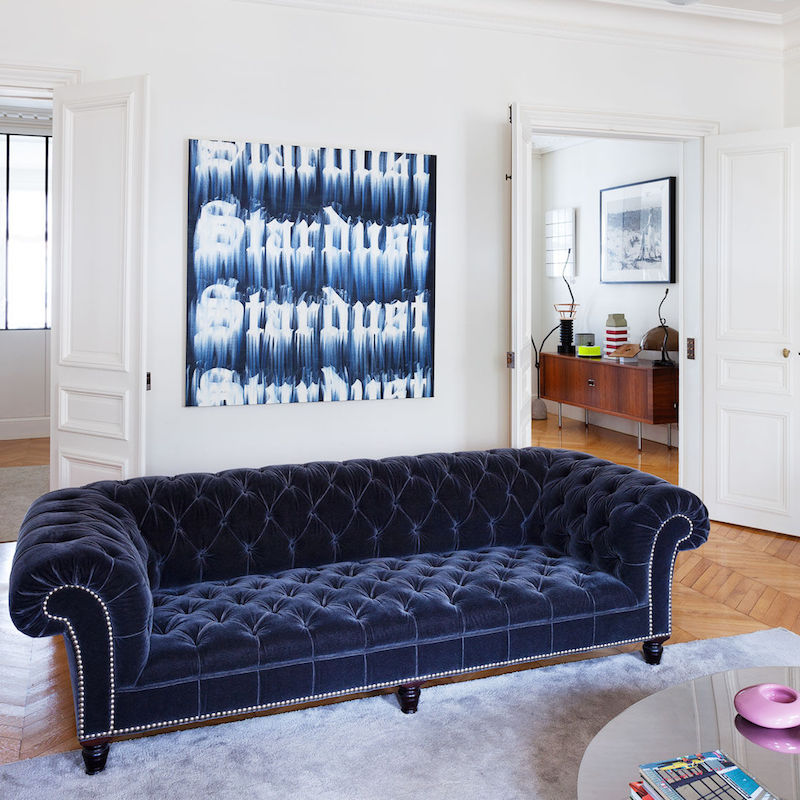 Blue Tufted Sofa in a Paris Living Room