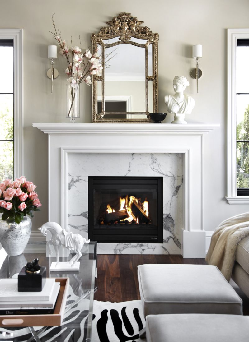 White Bust on Fireplace living room via The Design Co