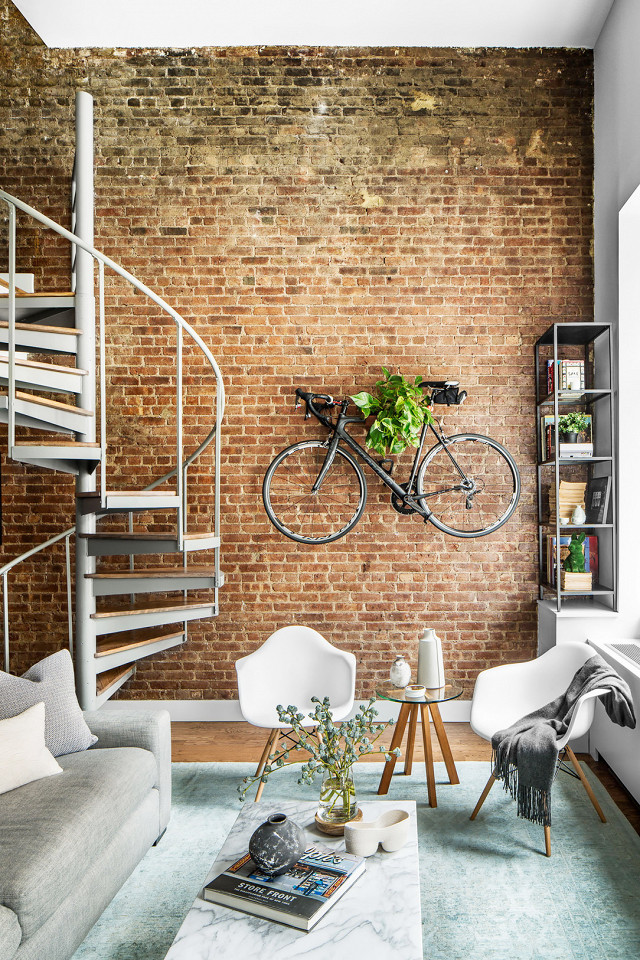 Brick wall loft via Homepolish