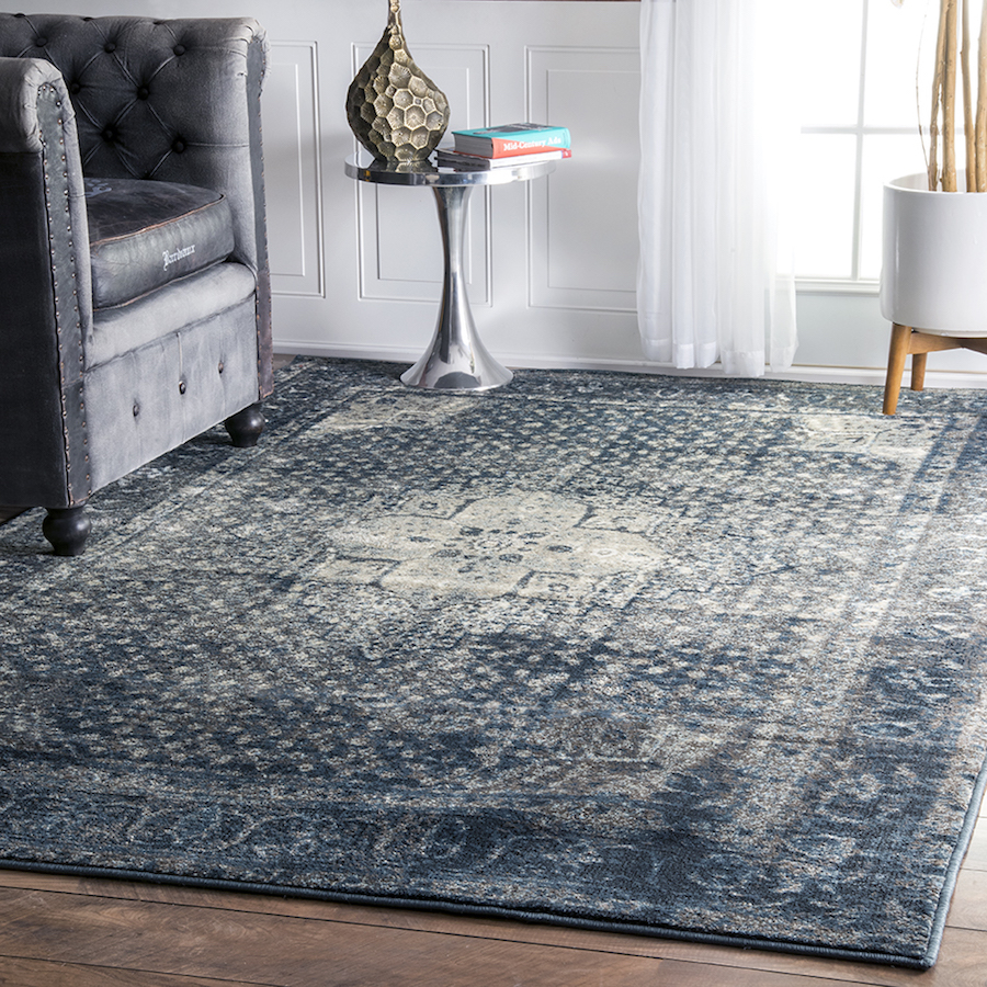 Dark blue overdyed faded rug
