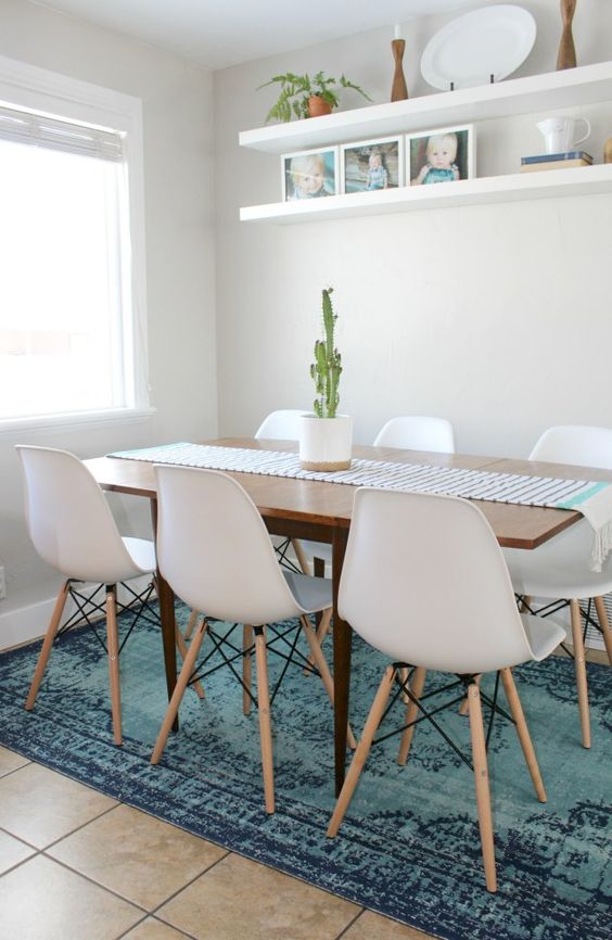 White dining room with blue overdyed rug