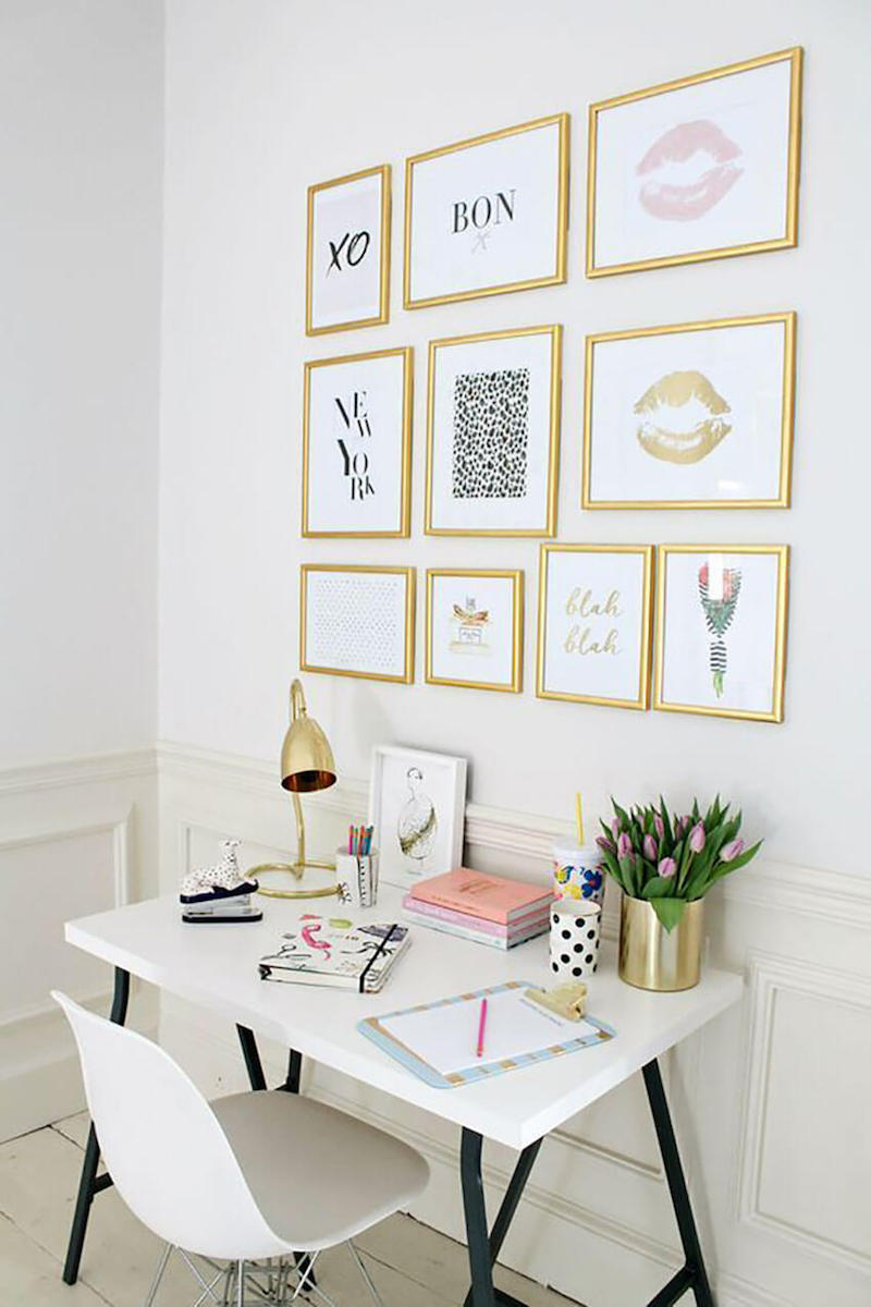 Gold gallery wall with white desk