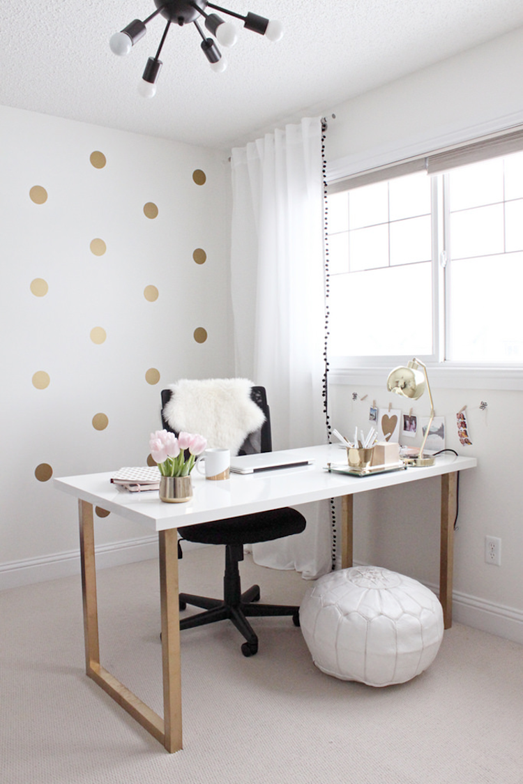 White ikea desk with gold legs, gold polkadot wallpaper
