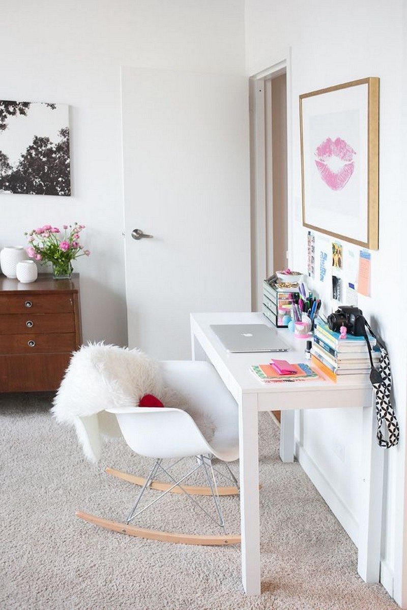 White minimalist desk with rocking office chair