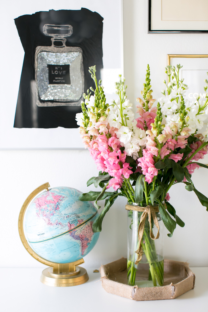 White desk with globe and flowers