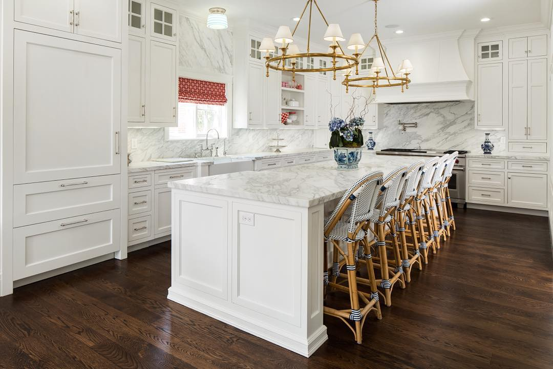 Fox Group designed this lovely white marble kitchen with plenty of French bistro style bar stools