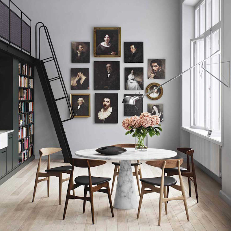 Mid-century modern marble dining table with gallery wall art
