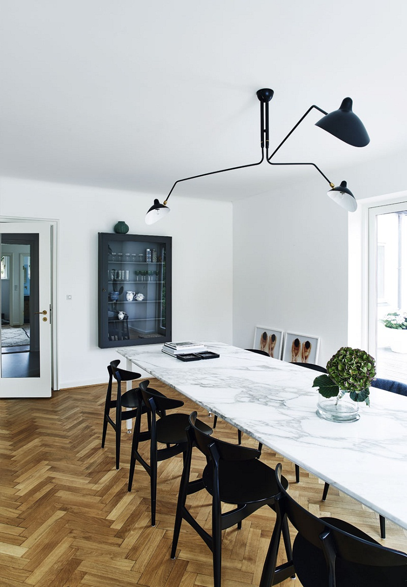 Sophisticated modern white marble dining table with black dining chairs