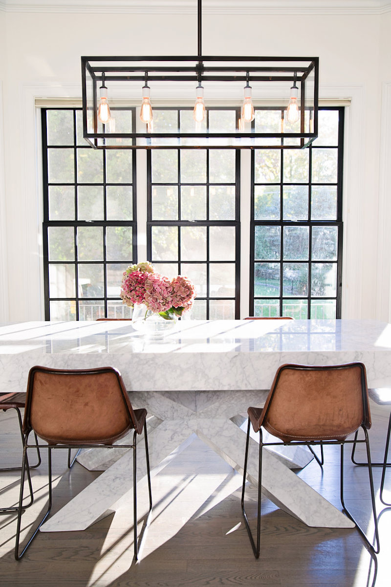 Thick Marble dining table with brown leather chairs