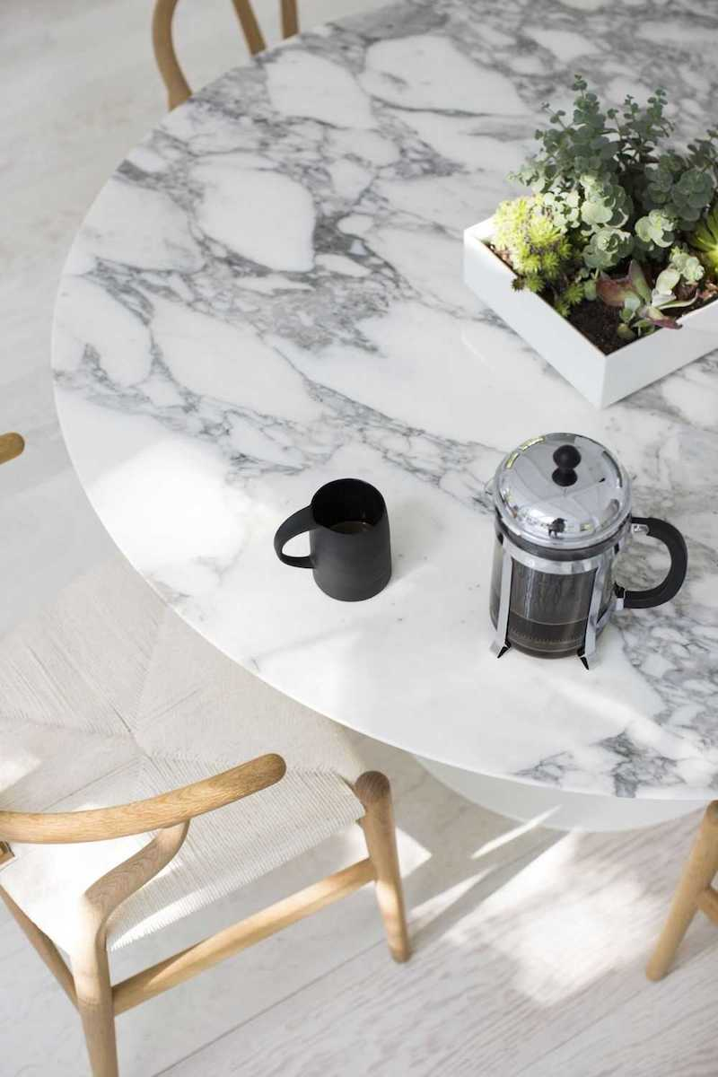 White Marble Dining Table with wishbone chairs and french press