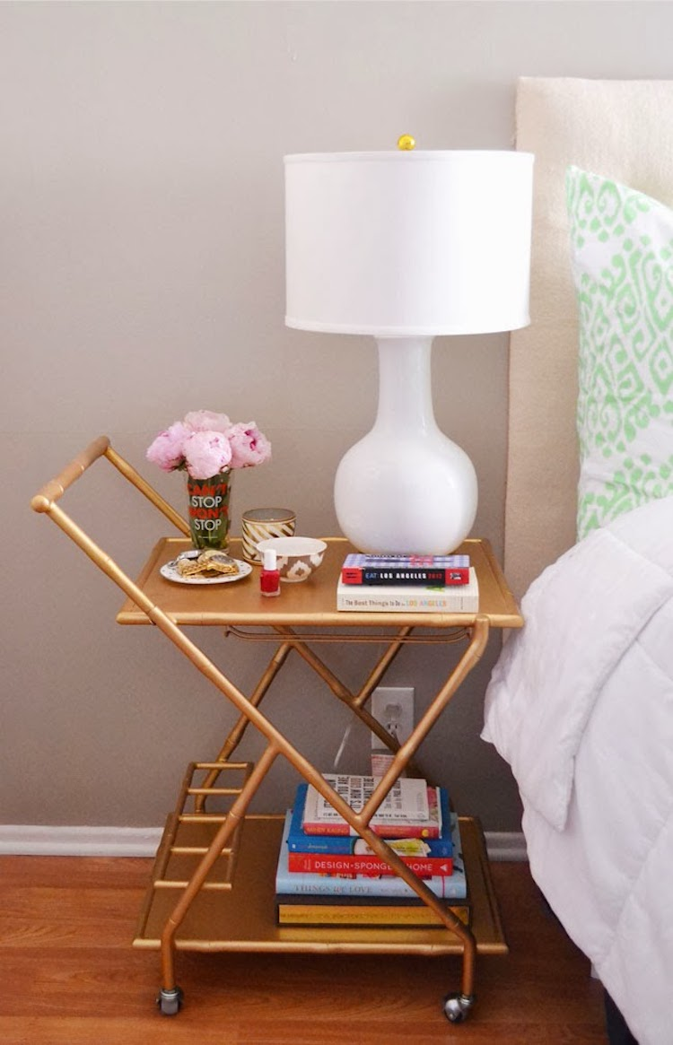 White table lamp on gold nightstand
