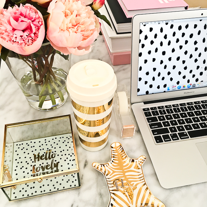 gold coffee cup with laptop and pink flowers