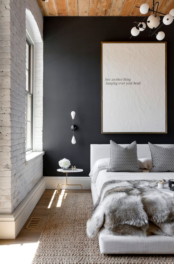 Black Wall Interior accent wall next to white brick wall