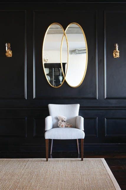 Black Wall Interior brighten the space with mirrors