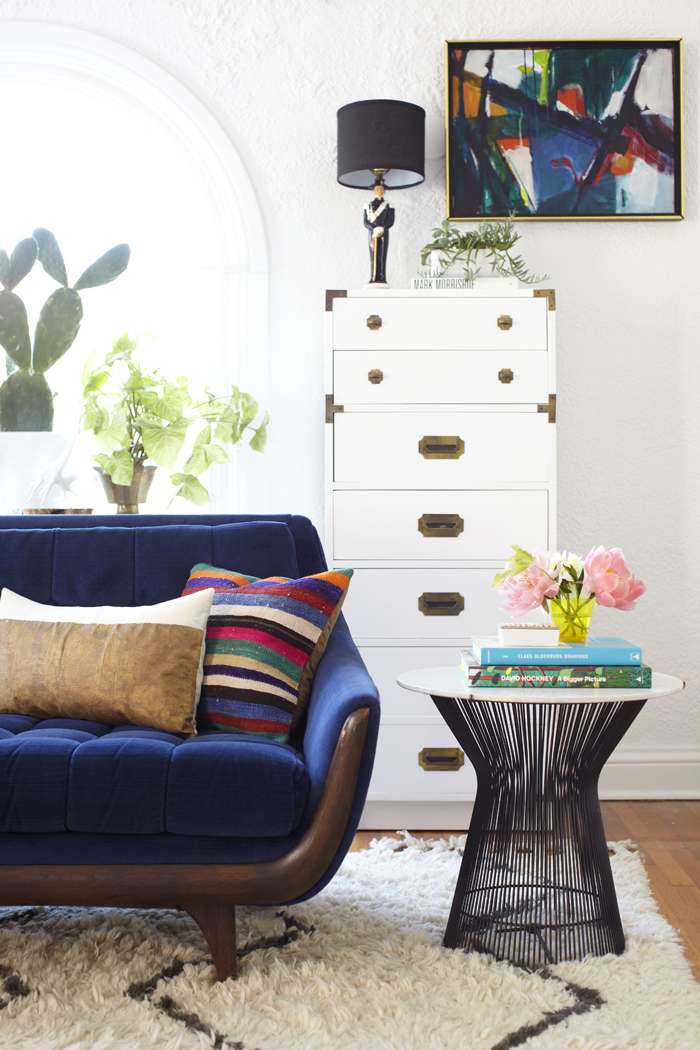 Lovely blue velvet sofa in Emily's living room