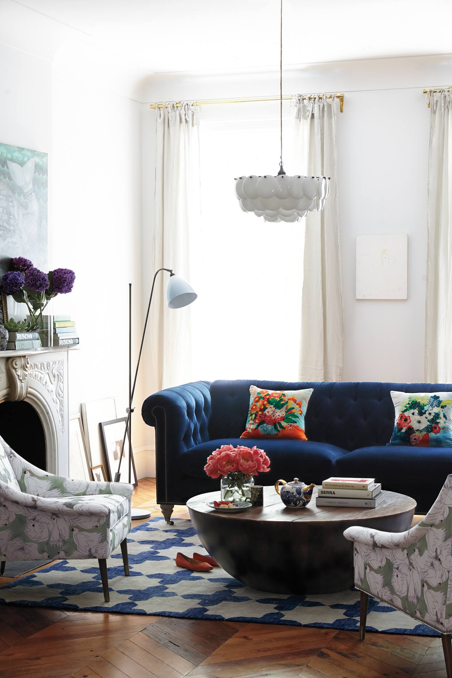 Shop this Blue Velvet Sofa Lyle Chesterfield Sofa from Anthropologie