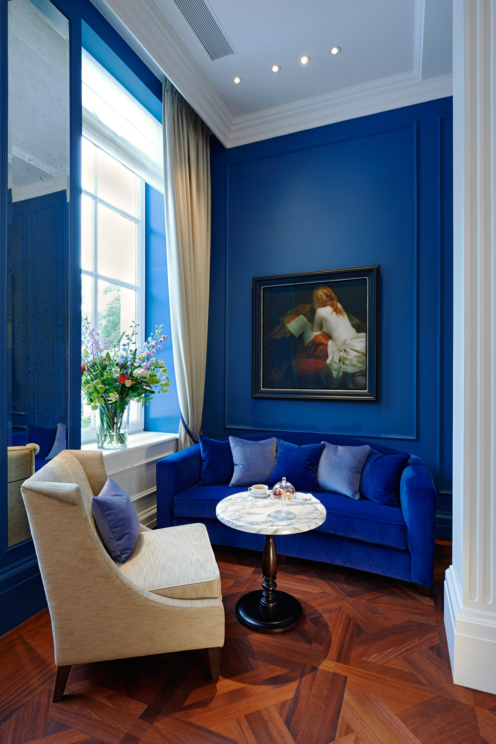 Blue Velvet Sofa Against Blue Wall via Vogue