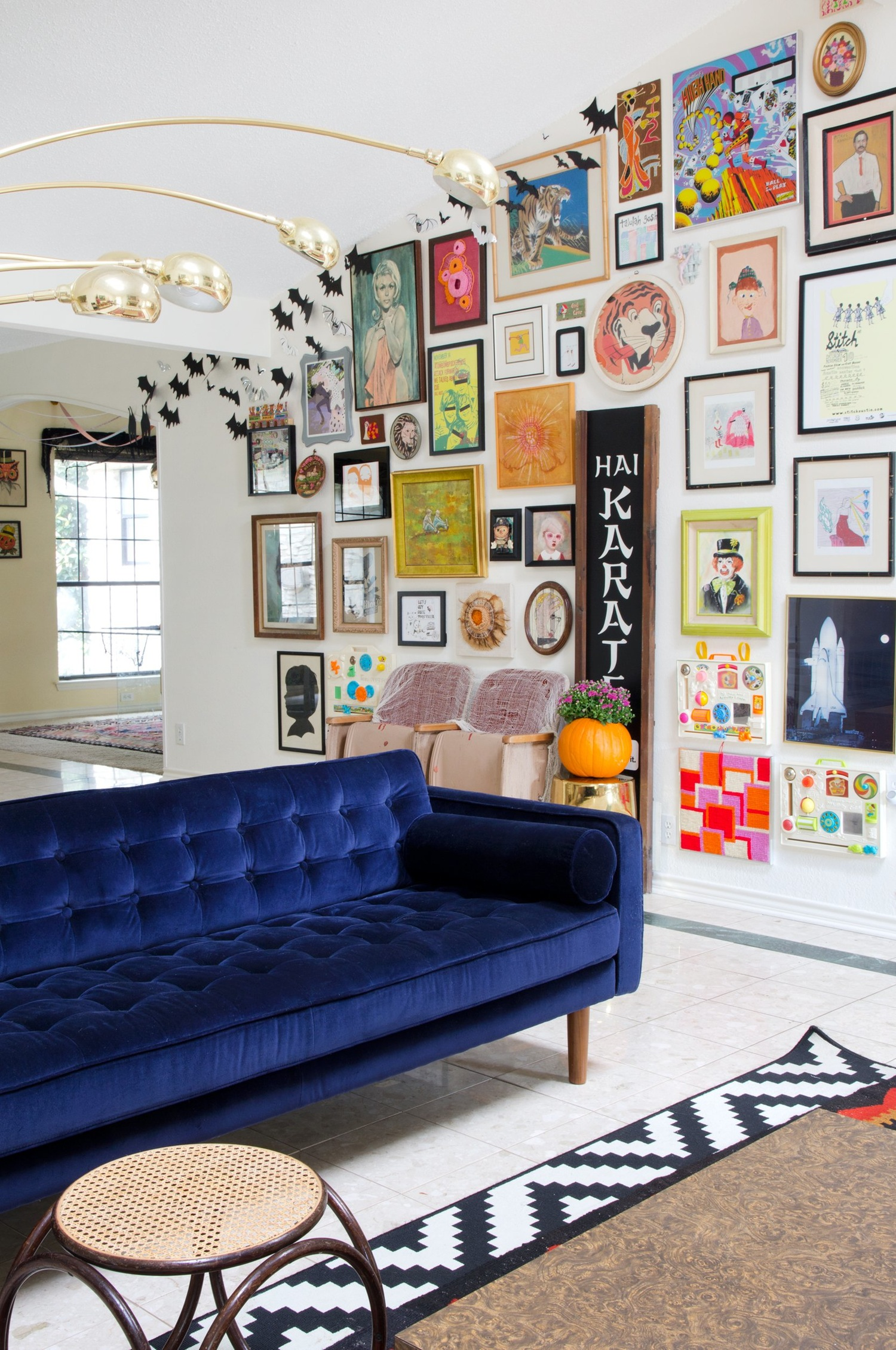 Blue Velvet Sofa with a Bright and Colorful Gallery Wall!