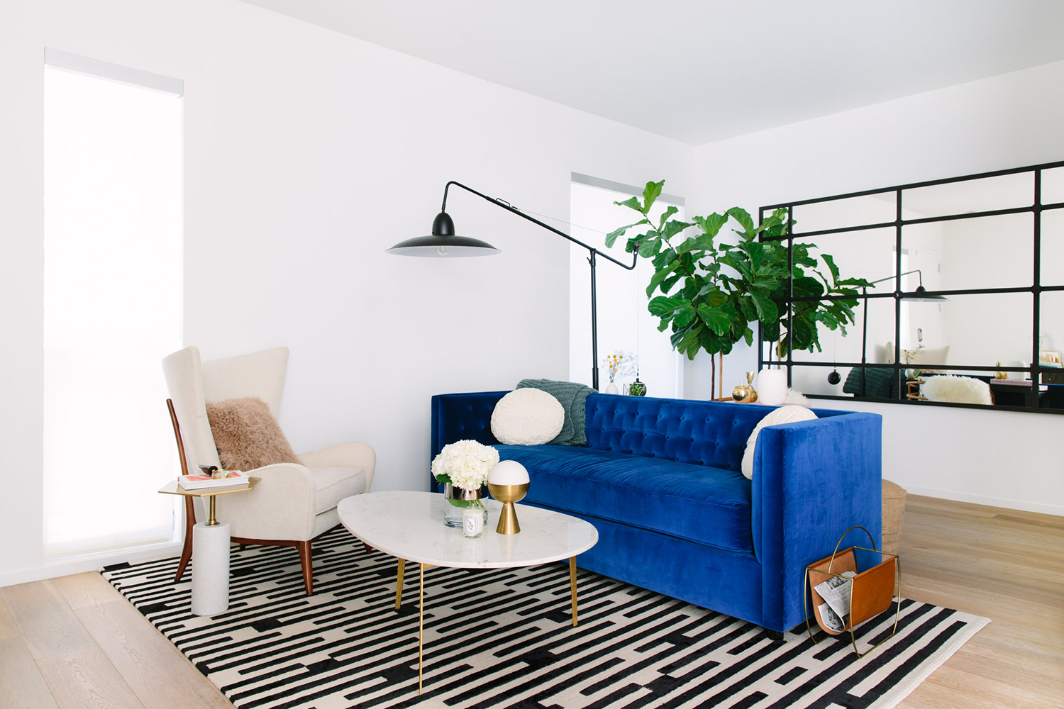 Blue Velvet Sofa with a black and white rug
