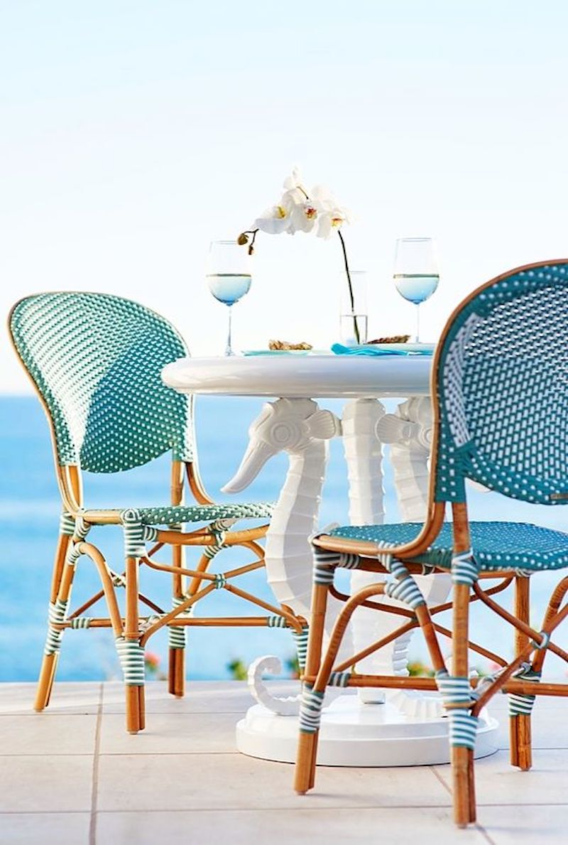 Azul blue french bistro chairs overlooking ocean via Frontgate
