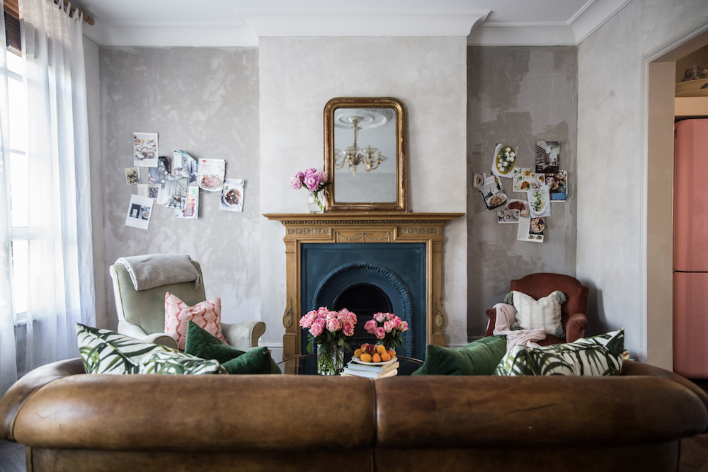 Brown Leather sofa in front of London Fireplace