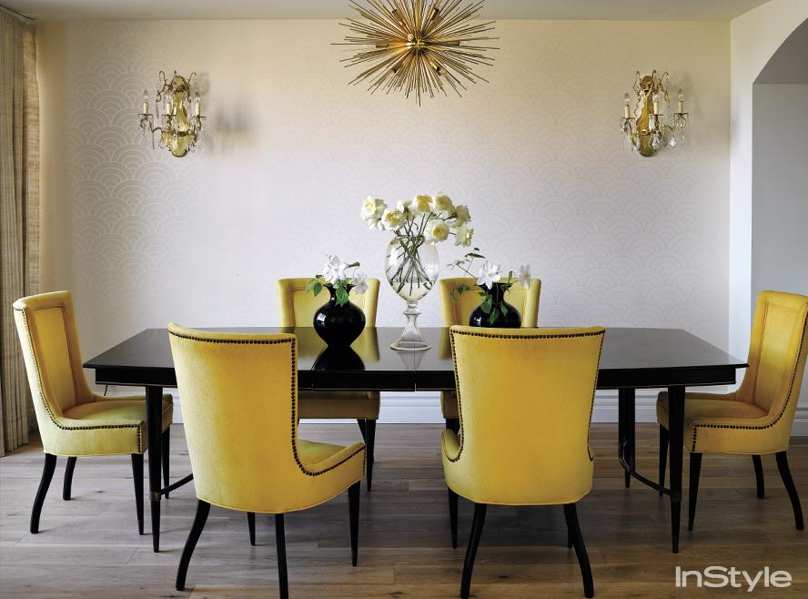 Cream dining room with yellow chairs