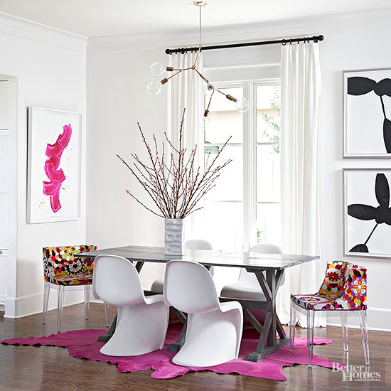 Dining Room with White Chairs and Pink Rug