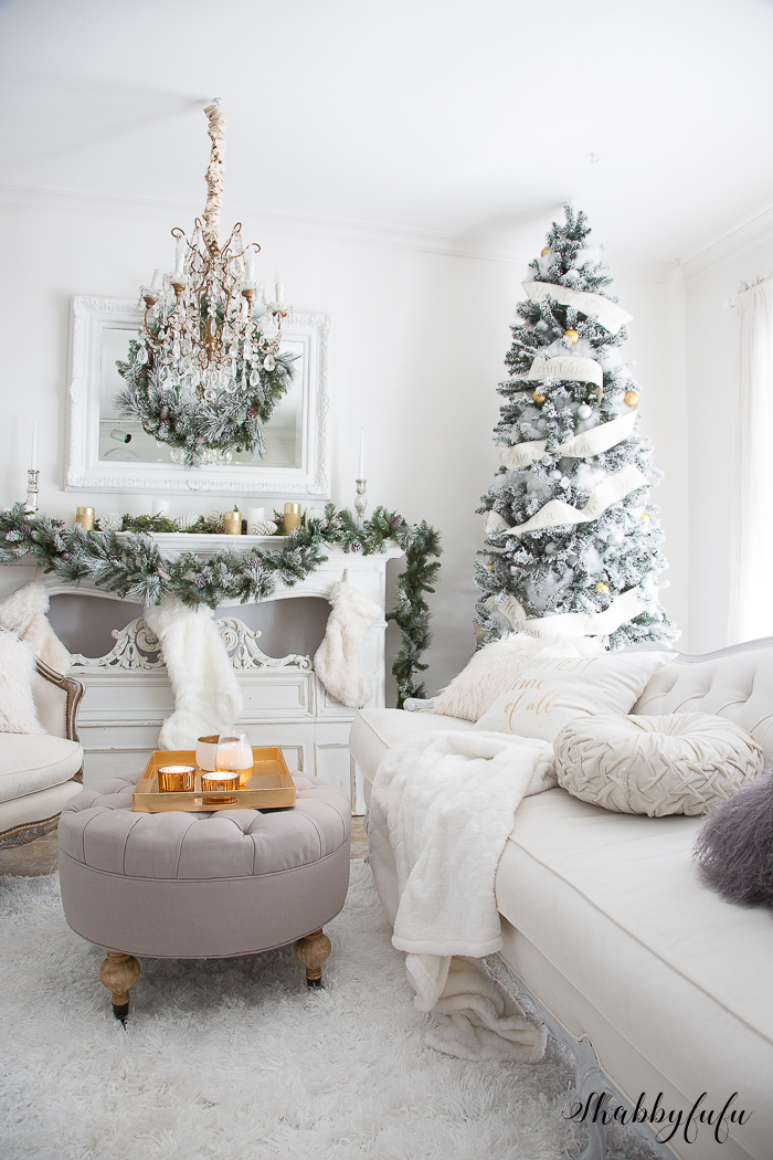 A Glamorous White Christmas Living Room With Tree And Mantel