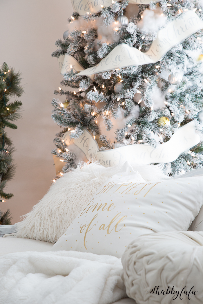 A Glamorous White Christmas Tree and Pillows