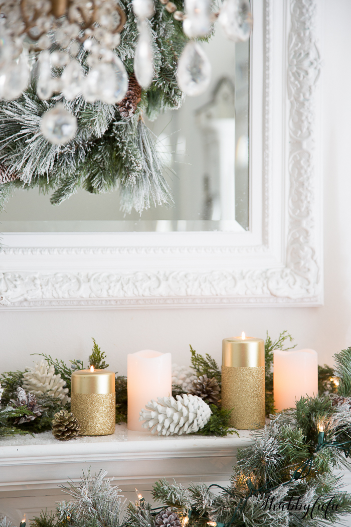Elegant White Christmas Candles on the Mantel