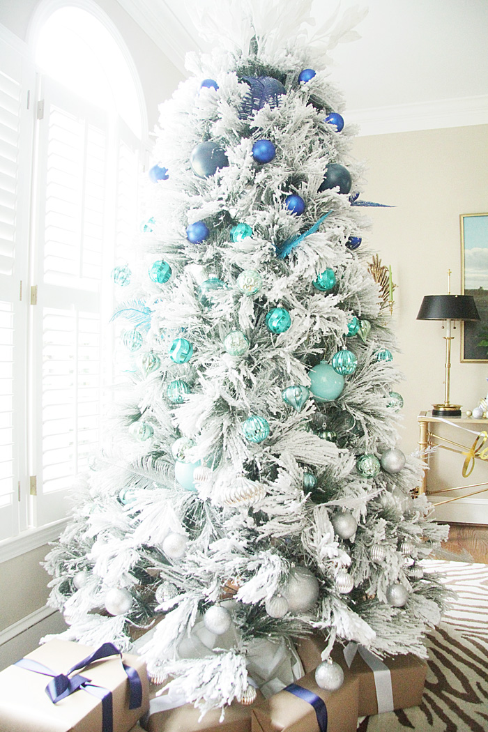 12 unique colorful christmas trees you 39 ll absolutely love for How to decorate a white christmas tree with blue lights