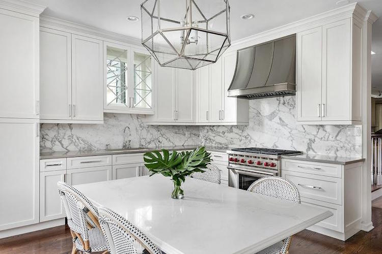 Marble Kitchen with French Bistro Chairs via Elizabeth Taich Design