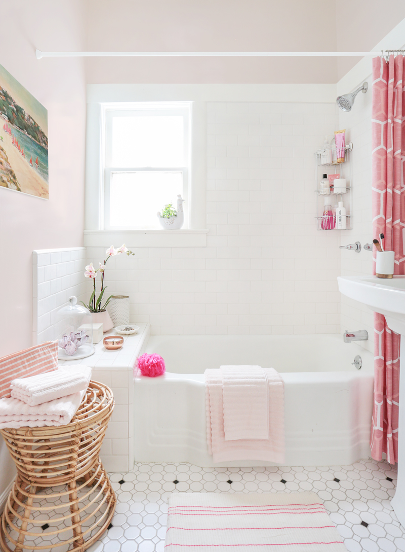 Pink Towels Draped over Tub