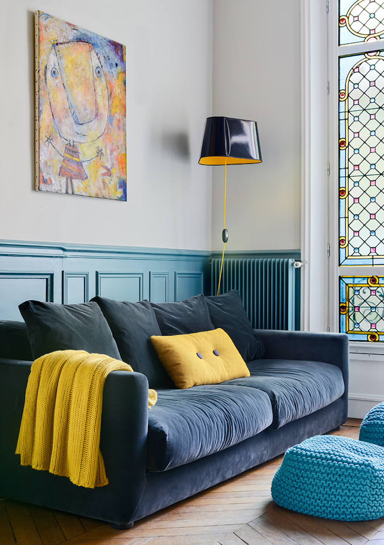 Blue couch with stained glass windows