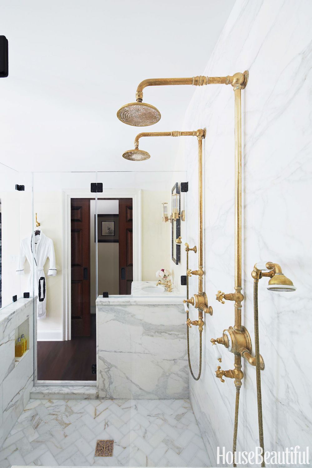 Brass Shower Heads in Marble Bathroom