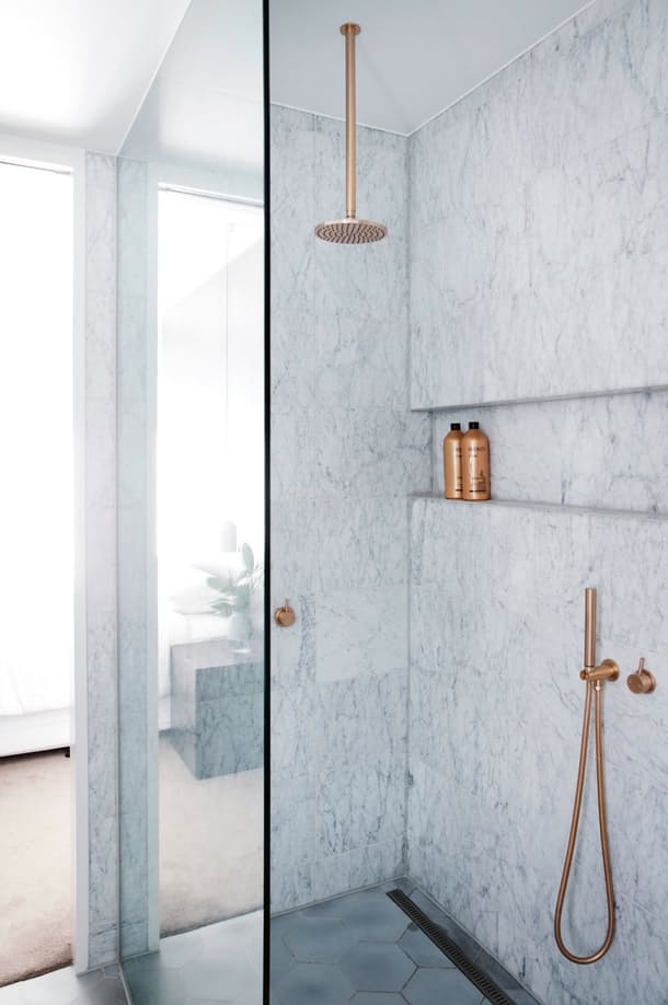 Brass Vertical Shower Head in Marble Shower