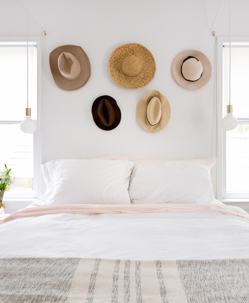 Claire Zinnecker Bedroom with hats on the wall