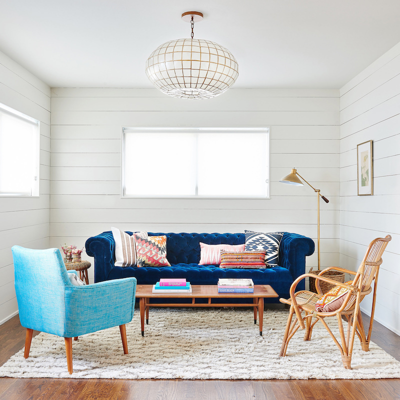 Claire Zinnecker Blue velvet couch with white paneling