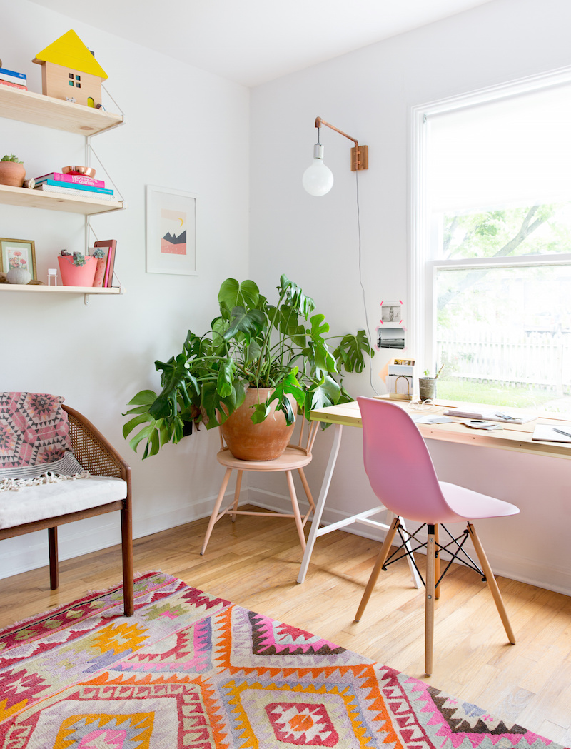 Claire Zinnecker Desk with pink chair and colorful rug