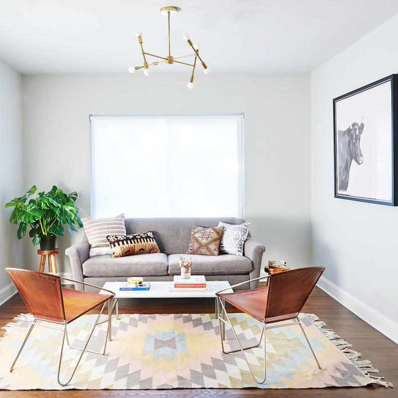 Claire Zinnecker Grey couch with geometric rug
