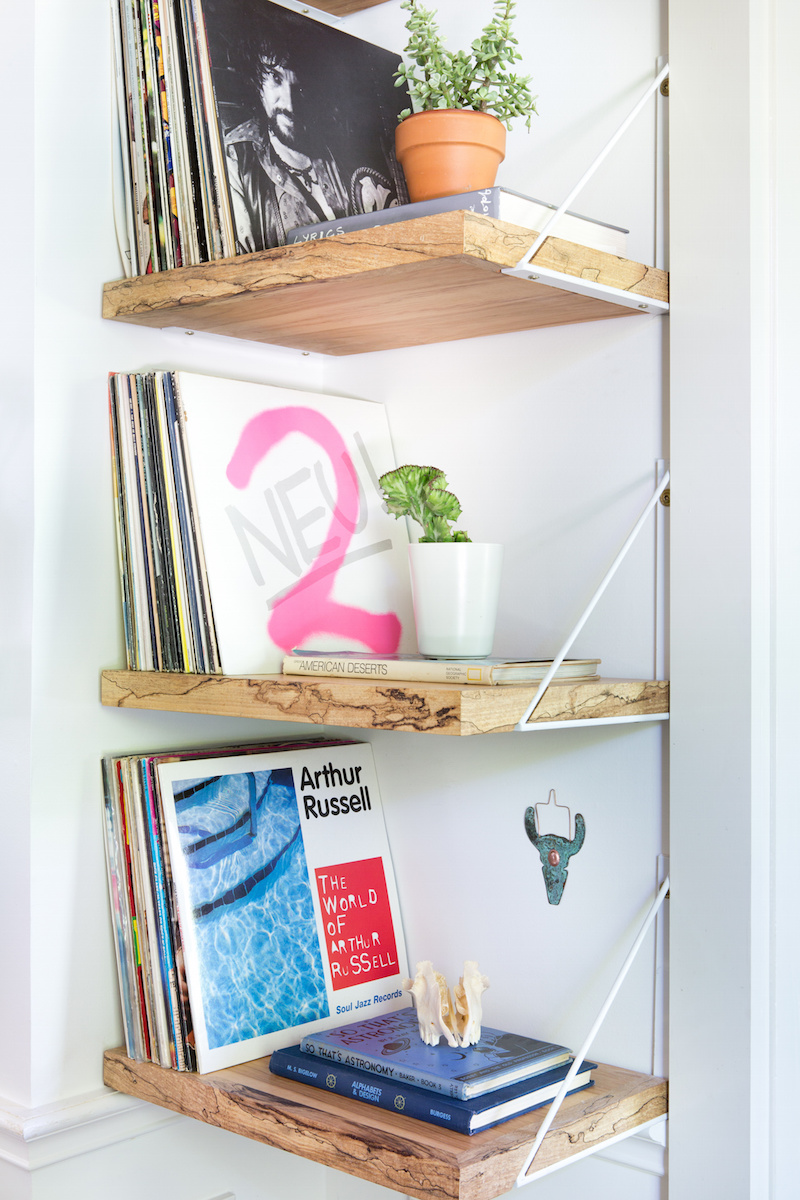 Claire Zinnecker Natural wood shelving with records