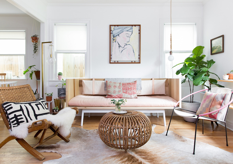 Claire Zinnecker Pink sofa with wicker coffee table