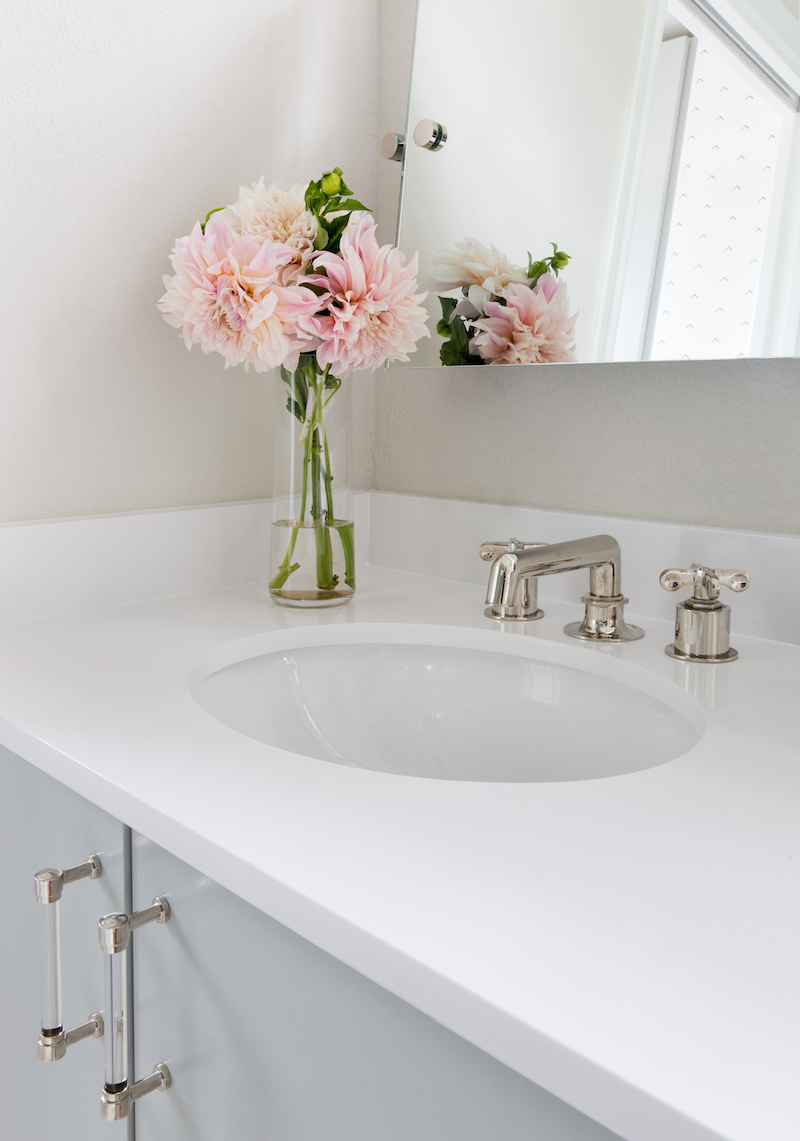 Claire Zinnecker White and blue Bathrooms with Pink Flowers