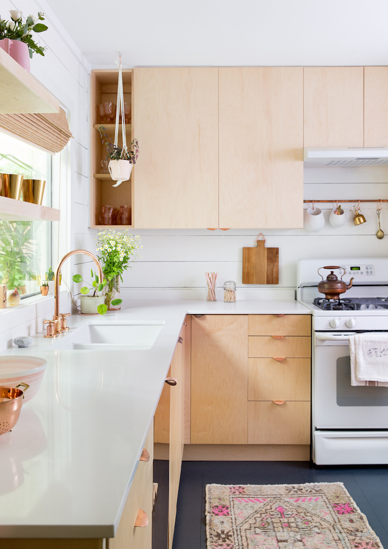 Claire Zinnecker Wood cabinet kitchen with Pink rug