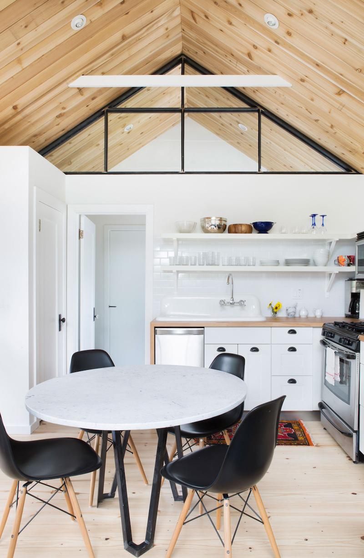 Claire Zinnecker Wooden floor kitchen nook with black chairs