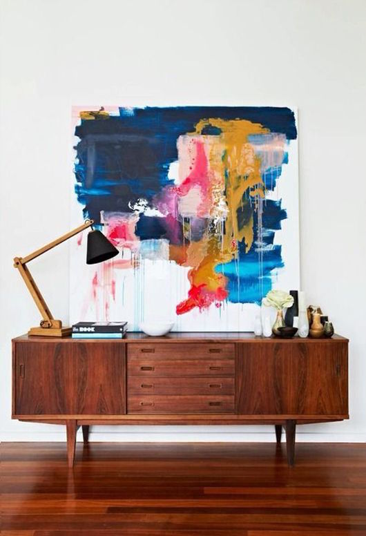 Dark Blue Abstract Artwork on Mid-Century Brown Sideboard