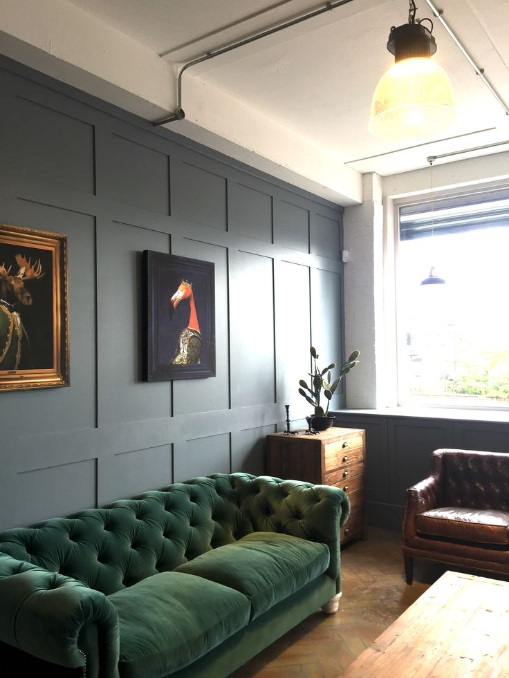 Dark Green Velvet Sofa with Blue walls