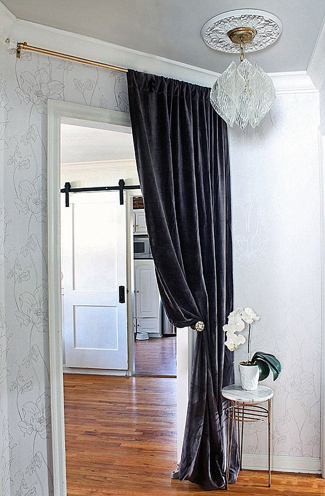 Dark Grey Curtains with Chandelier and Marble Table