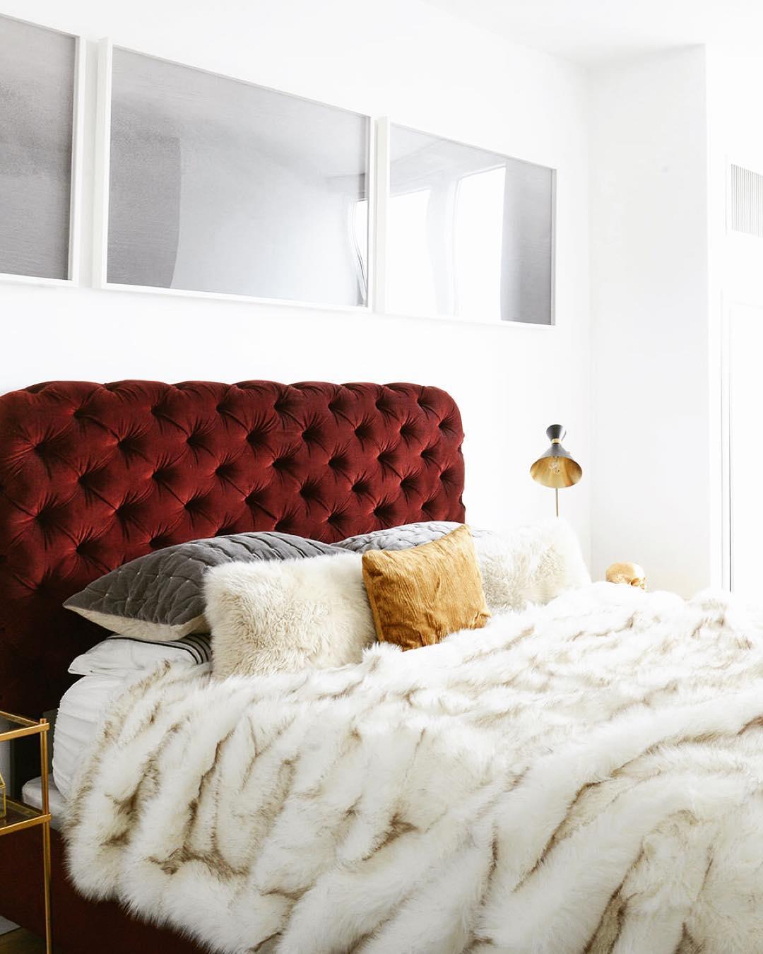 Dark Red Tufted Velvet Headboard with White Fur Throw